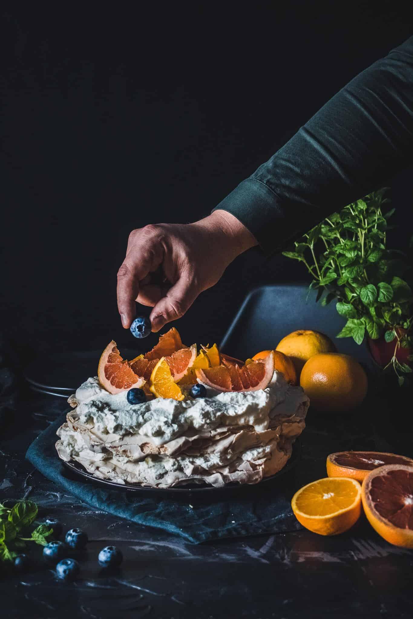 Blood orange Pavlova with blueberries.